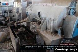 Машина для производства оливкового масла в цехе завода, разрушнного, предположительно, в результате бомбардировок российской авиации 13 ноября