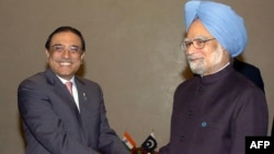 Pakistani President Asif Ali Zardari (left) and Indian Prime Minister Manmohan Singh shake hands on the sidelines of a summit in Yekaterinburg, Russia, in 2009.