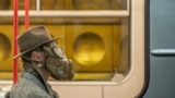 CZECH REPUBLIC -- A man wears a mask as he sits in the metro in Prague, March 17, 2020