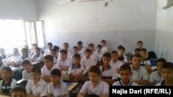 صف بمدرسة في بغداد