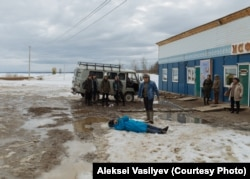 Filming a scene for Davydov's latest movie, The Illegal, on the outskirts of Amga.