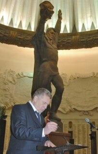 Nationalist Vladimir Zhirinovsky signs the