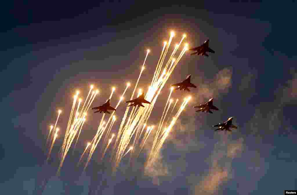 Belarusian MiG-29 jet fighters take part in a rehearsal for a military parade in Minsk. (Reuters/Vasily Fedosenko)