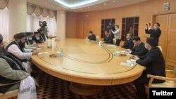 Taliban deputy leader Mullah Abdul Gani Baradar (left) holds talks with Turkmen Foreign Minister Rashid Muradov (right) in Ashgabat on February 6.