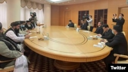 The Taliban delegation holding talks with Turkmen Foreign Minister Rashid Meredov (right) in Ashgabat on February 6