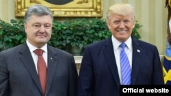 Ukrainian President Petro Poroshenko (left) and U.S. President Donald Trump pose in the Oval Office at the White House in Washington, D.C., on June 20, 2017.