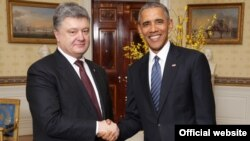 U.S. President Barack Obama greets Ukrainian President Petro Poroshenko at the Nuclear Security Summit in Washington on April 1.