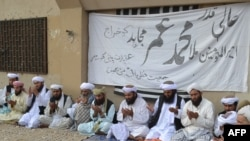 Pakistani supporters of the Afghan Taliban praying for late Mullah Mohammad Omar in July.
