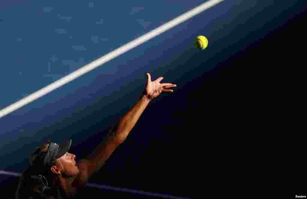 Maria Sharapova of Russia serves to compatriot Ekaterina Makarova during their women's singles quarter-final match at the Australian Open tennis tournament in Melbourne. (Reuters/David Gray)