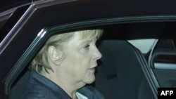 German Chancellor Angela Merkel arrives at the chancellery after a suspicious package was discovered there.