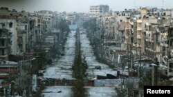 Syria -- A general view shows a damaged street with sandbags used as barriers in Aleppo's Saif al-Dawla district, March 6, 2015
