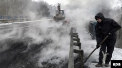 Burning tires are prepared in an effort to block the international E40 highway in Ukraine.