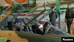 Iranian President Hassan Rohani is seen in the newly unveiled Kowsar fighter jet in Tehran on August 21.