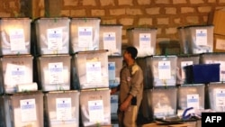 Sealed ballot boxes at a warehouse in Al-Ramadi following the vote