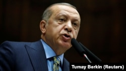 Turkish President Tayyip Erdogan told parliament on October 23 that a team of Saudi agents began arriving in Turkey the day before journalist Jamal Khashoggi was killed.