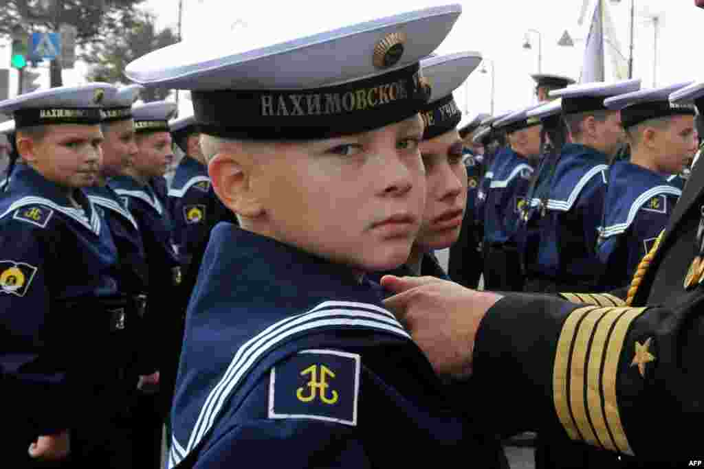 """Young cadets at the Nakhimov Naval Academy in St. Petersburg attend a ceremony for the so-called """"Day of Knowledge"""" as the school year begins."""