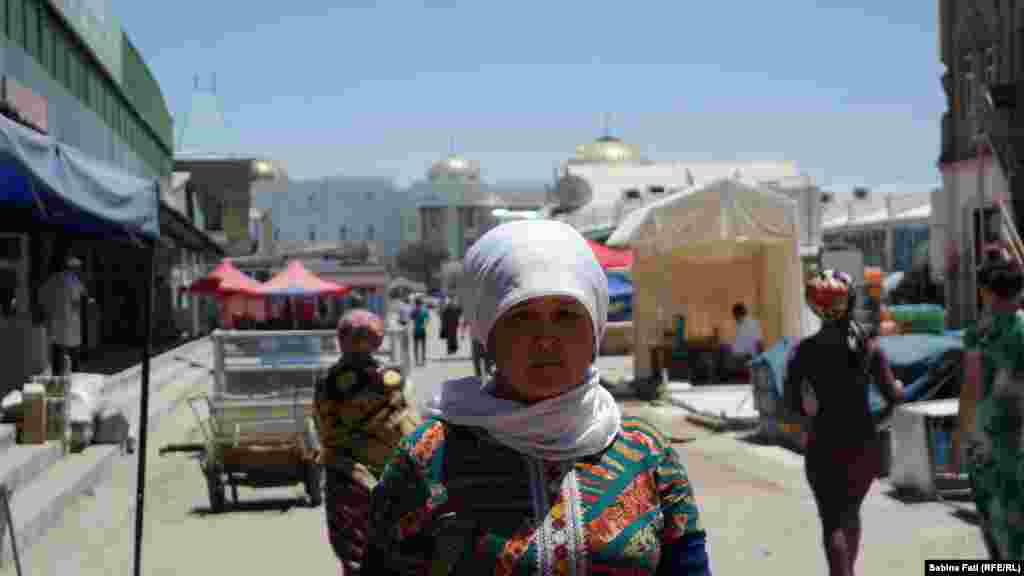 A woman on the street in Merv, Turkmenistan. June 16, 2014.