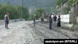 Armenia - A highway passing through Vahagnadzor village under construction.