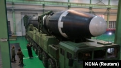 SOUTH KOREA -- FILE PHOTO: North Korea's leader Kim Jong Un is seen as the newly developed intercontinental ballistic rocket Hwasong-15Õs test was successfully launched, in this undated photo released by North Korea's Korean Central News Agency (KCNA) in