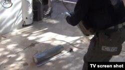 Сириядағы химиялық қарудың құтысы деп YouTube желісіне жарияланған видеодан скриншот.