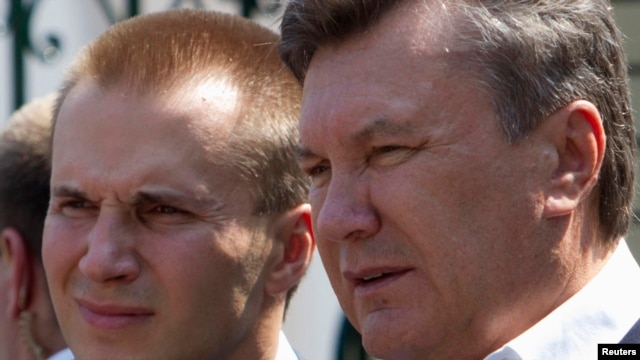 Then-President Viktor Yanukovych (right) is pictured with his son Oleksandr in April 2010.