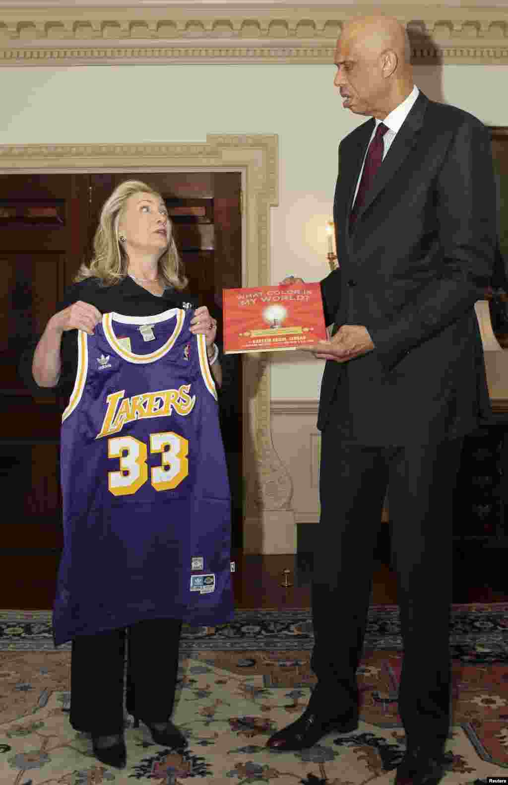 Clinton (left) accepts a Los Angeles Lakers uniform from NBA legend and State Department cultural ambassador Kareem Abdul-Jabbar during their meeting in Washington on January 18, 2012.