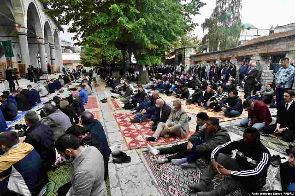 Bosnian Muslims wear face masks as they pray in front of the Gazi Husrev-beg Mosque in Sarajevo.