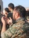 شماری از نیروهای فاطمیون، سازماندهی شده توسط جمهوری اسلامی، در یکی از پایگاههای این گروه در سوریه