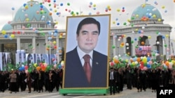People carry a giant portrait of Berdymukhammedov during Independence Day celebrations in Ashgabat in 2009.