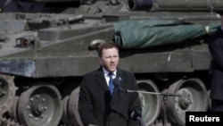 Estonian Defense Minister Margus Tsahkna speaks during an official ceremony welcoming the deployment of a multinational NATO battalion in Tapa earlier this month.