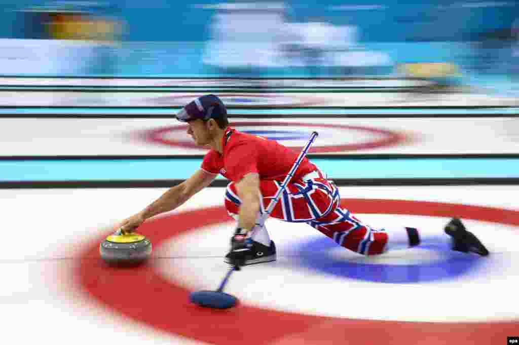 Skip Thomas Ulsrud of Norway practices ahead of the curling tournament at the Ice Cube Curling Center in Sochi.