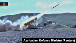 A multiple rocket launcher of the Azerbaijani armed forces fires during clashes over the breakaway region of Nagorno-Karabakh in an unknown location in Azerbaijan.