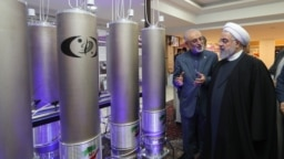 Iranian President Hassan Rohani (right) inspects a nuclear facility in Tehran earlier this year.