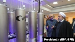 Iranian President Hassan Rohani and head of Iran's nuclear technology organisation Ali Akbar Salehi (2-R) visit a nuclear facility during the National Nuclear Technology Day in Tehran, April 9, 2019