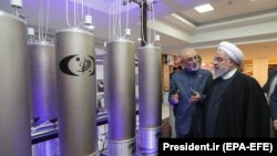 Iranian President Hassan Rouhani and head of Iran's nuclear technology organisation Ali Akbar Salehi (2-R) visit a nuclear facility during the National Nuclear Technology Day in Tehran, April 9, 2019
