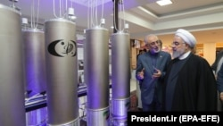 Iranian President Hassan Rouhani and head of Iran's nuclear technology organization Ali Akbar Salehi (2-R) visit a nuclear facility during the National Nuclear Technology Day in Tehran, April 9, 2019
