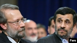 Parliament speaker Ali Larijani (left) and President Mahmud Ahmadinejad at a gathering of the parliament and cabinet in February