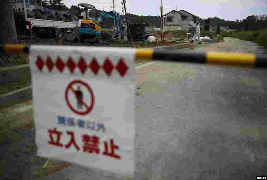 A no-entry sign in the town of Naraha, inside the 20-kilometer radius around the crippled plant that was temporarily a no-go zone.