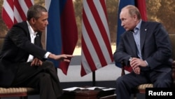 U.S. President Barack Obama (left) and his Russian counterpart Vladimir Putin at the G8 summit in Northern Ireland in 2013.