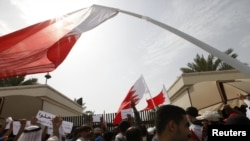 Protesters block the entrances to the upper house of Bahrain's National Assembly in Manama on February 28.