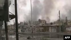 Дым над сирийским городом Хомс.