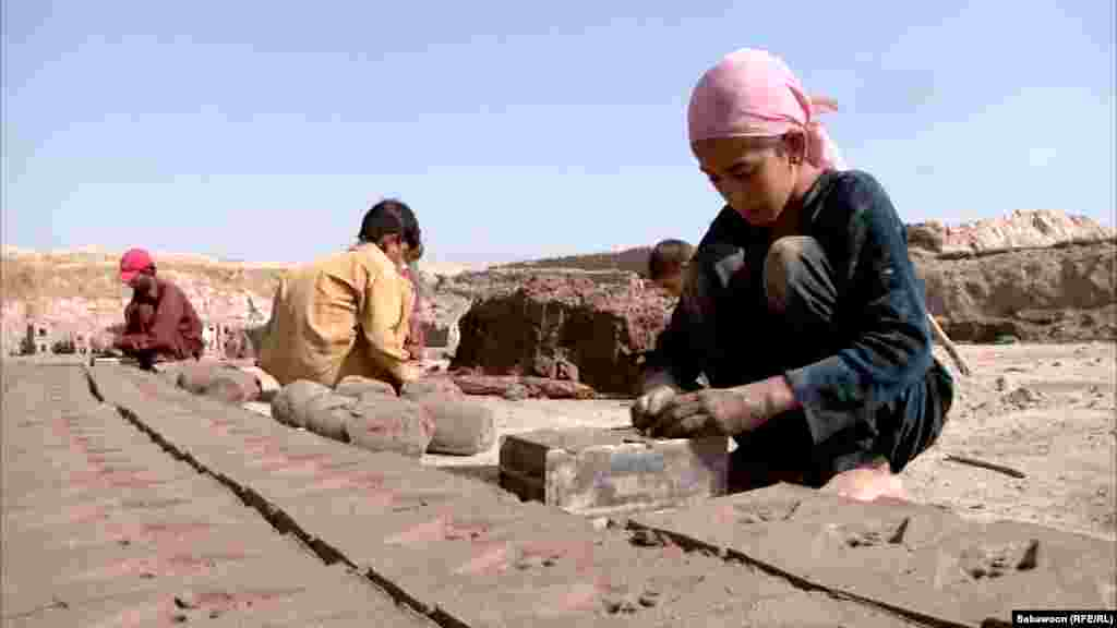 Hamida Khan, who is 8 years old, is one of the children working as a bonded laborer at the brick kiln in Nangarhar.