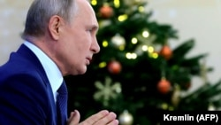 RUSSIA -- Russian President Vladimir Putin addresses his annual press conference via a video link at the Novo-Ogaryovo state residence outside Moscow, December 17, 2020