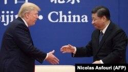 АҚШ президенті Дональд Трамп пен Қытай төрағасы Си Цзиньпин. Пекин, 11 қараша 2017 жыл.
