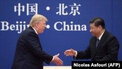 Дональд Трамп и Си Цзиньпин. Архивное фото.