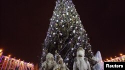 Father Frosts and Snow Maidens stand near a decorated tree in the Kyrgyz capital. (file photo)
