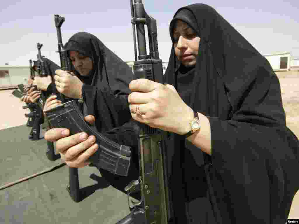 Iraqi policewomen practice assembling and disassembling a Kalashnikov automatic rifle during a training course at a police academy in Karbala, 80 kilometers southwest of Baghdad. Photo by Mushtaq Muhammed for Reuters.