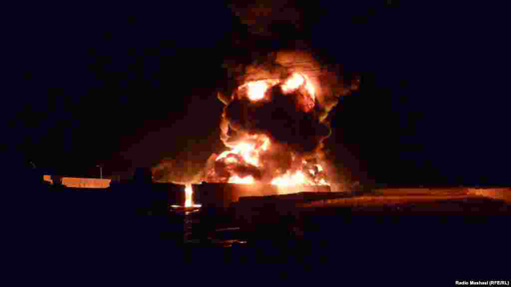 NATO oil tankers and goods trucks are set ablaze during an attack by gunmen in Quetta, Pakistan, on December 8. (Photo by RFE/RL's Radio Mashaal)