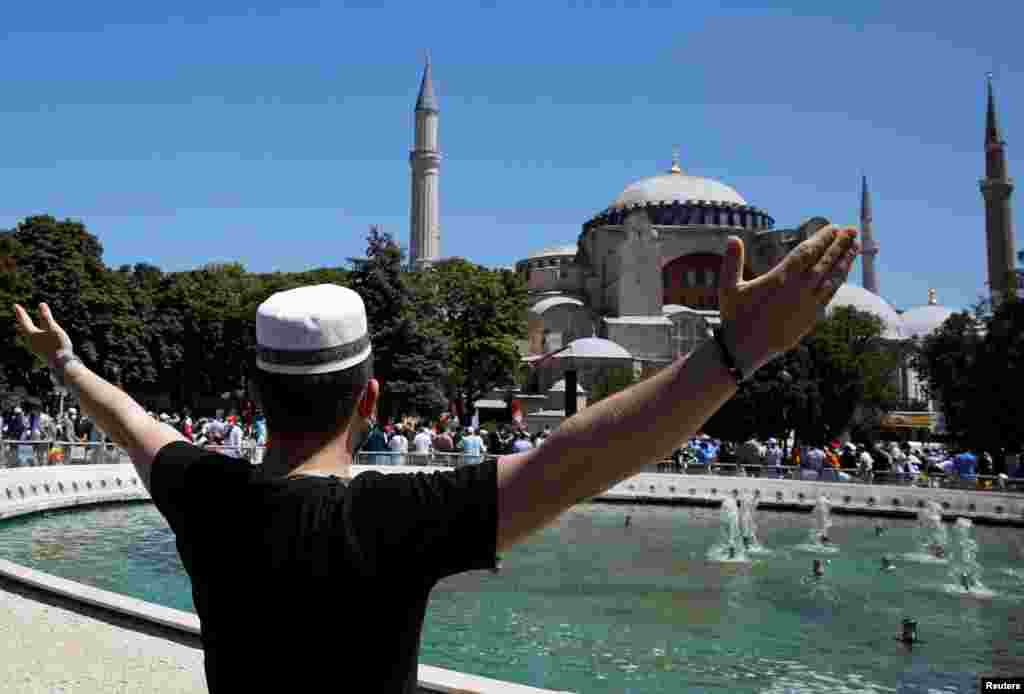 A man celebrates in front of Hagia Sophia on July 24 as crowds await the ancient structure's opening for Friday prayers.