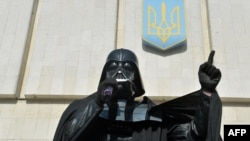 "A man wearing the outfit of iconic ""Star Wars"" villain Darth Vader at a public appearance on behalf of the Ukrainian Internet Party (UIP)."